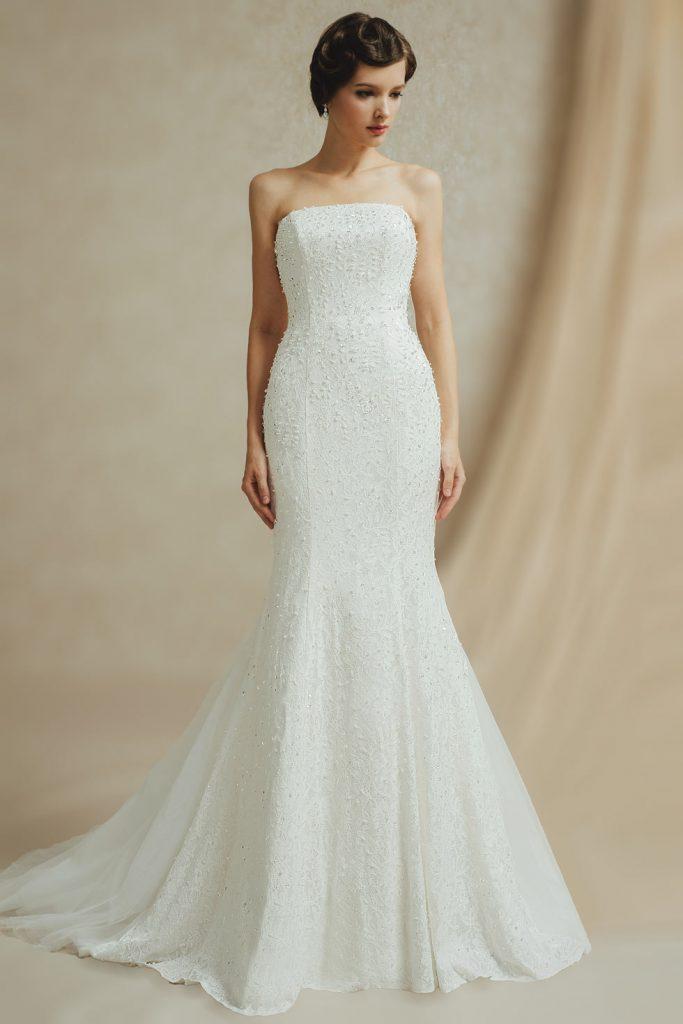 Robe de mariée en dentelle sans manche strass ceinture