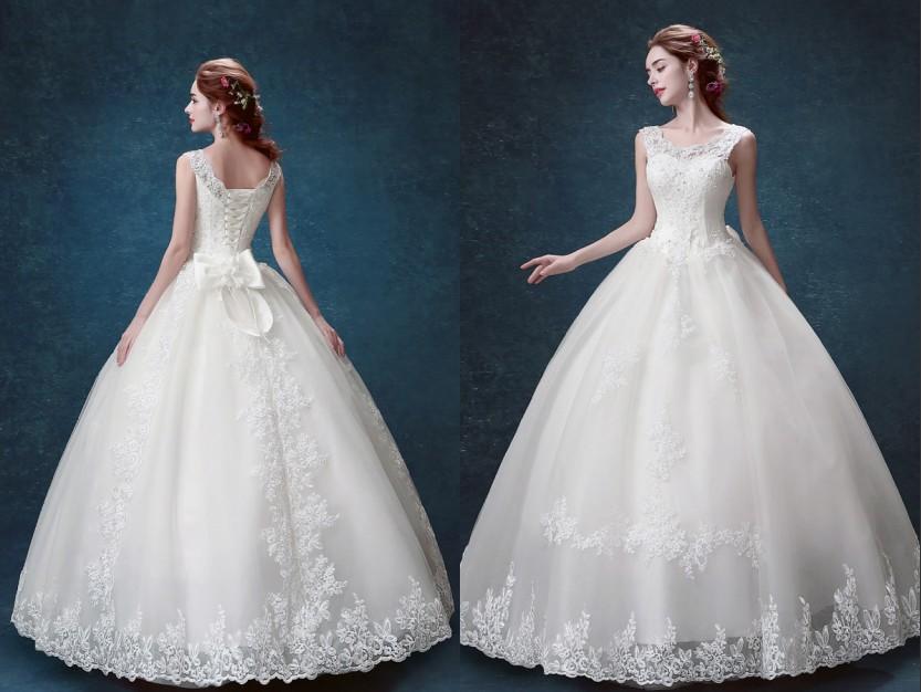 Robe de mariée en dentelle grand noeud papillon orné